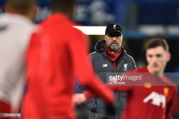 Liverpool's German manager Jurgen Klopp watches his players warm up ahead of the English FA Cup fifth round football match between Chelsea and...