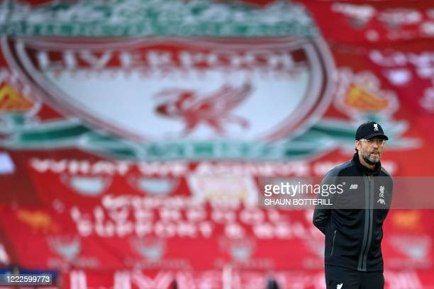 Liverpool's German manager Jurgen Klopp watches his players warm up ahead of the English Premier League football match between Liverpool and Crystal...