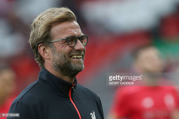 Liverpool's German manager Jurgen Klopp watches his players warm up ahead of the English Premier League football match between Liverpool and Hull...