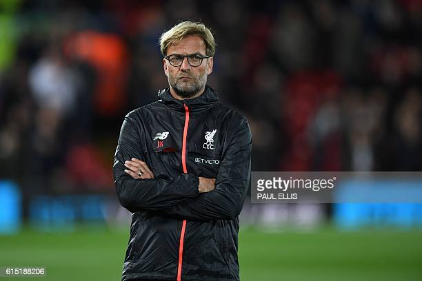 Liverpool's German manager Jurgen Klopp watches his players warm up ahead of the English Premier League football match between Liverpool and...