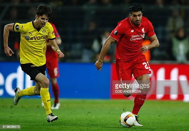 Liverpool's German midfielder Emre Can and Dortmund's midfielder Julian Weigl vie for the ball during the UEFA Europe League quarterfinal firstleg...