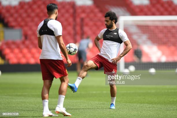 Liverpool's German midfielder Emre Can and Liverpool's Egyptian midfielder Mohamed Salah attends a training session and media day at Anfield stadium...