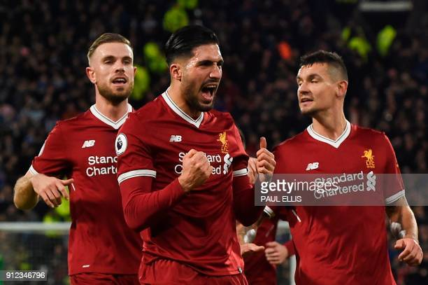 Liverpool's German midfielder Emre Can celebrates scoring the opening goal during the English Premier League football match between Huddersfield Town...