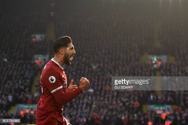 TOPSHOT Liverpool's German midfielder Emre Can celebrates scoring the team's first goal during the English Premier League football match between...
