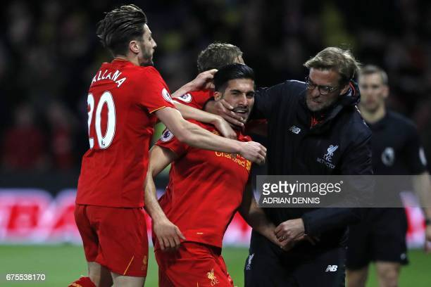 Liverpool's German midfielder Emre Can celebrates with Liverpool's English midfielder Adam Lallana and Liverpool's German manager Jurgen Klopp after...
