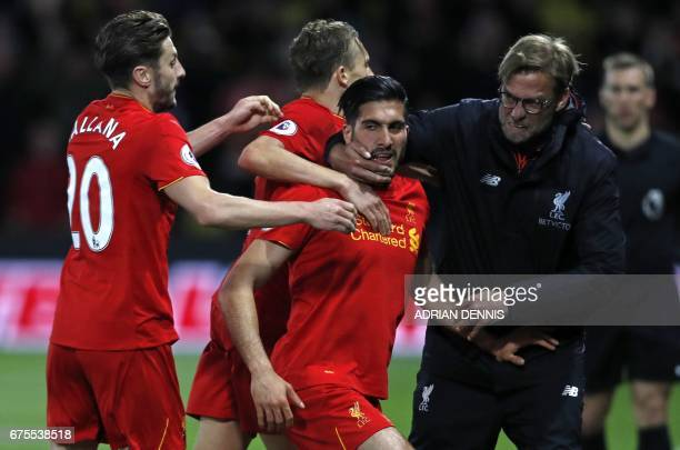 Liverpool's German midfielder Emre Can celebrates with Liverpool's English midfielder Adam Lallana Liverpool's Brazilian midfielder Lucas Leiva and...