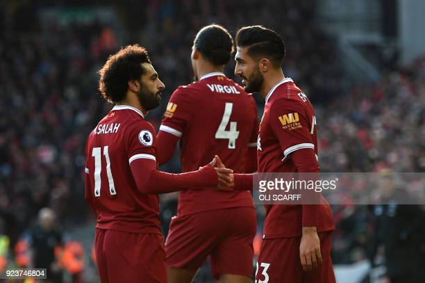Liverpool's German midfielder Emre Can celebrates with Liverpool's Egyptian midfielder Mohamed Salah scoring the team's first goal during the English...
