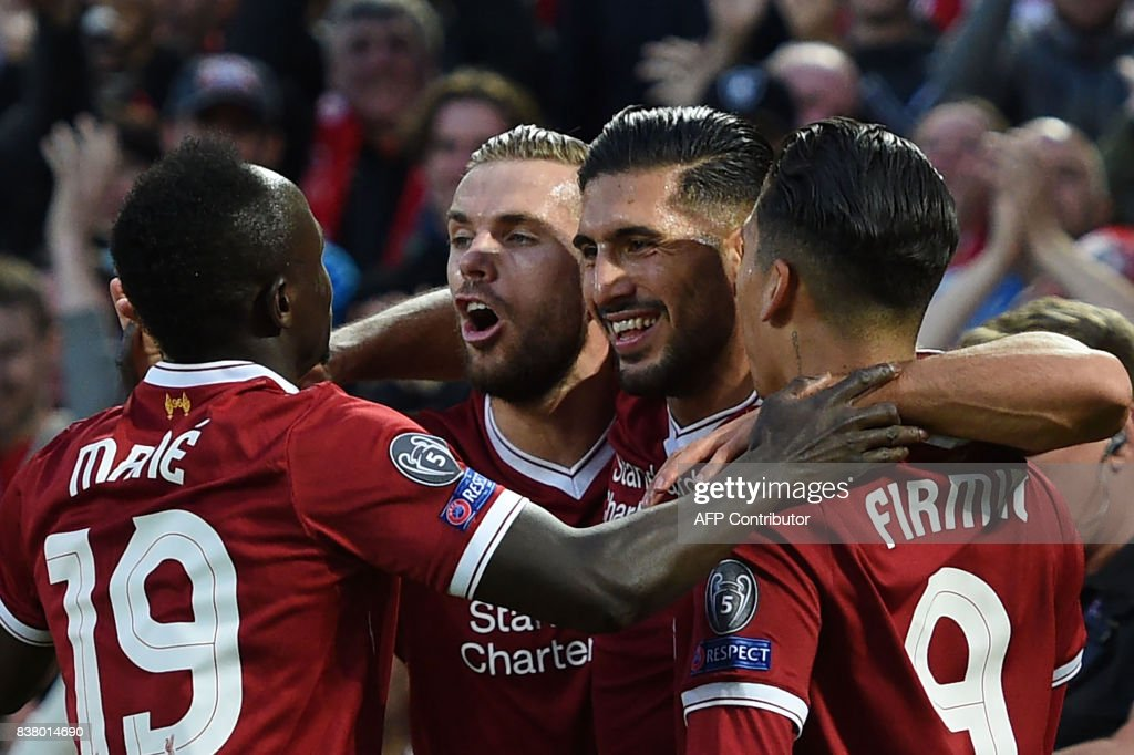 TOPSHOT - Liverpool's German midfielder Emre Can (2R) celebrates with teammates scoring his team's first goal during the Champions League qualifier, second leg match between Liverpool and Hoffenheim at Anfield stadium in Liverpool on August 23, 2017. / AFP PHOTO / Oli SCARFF
