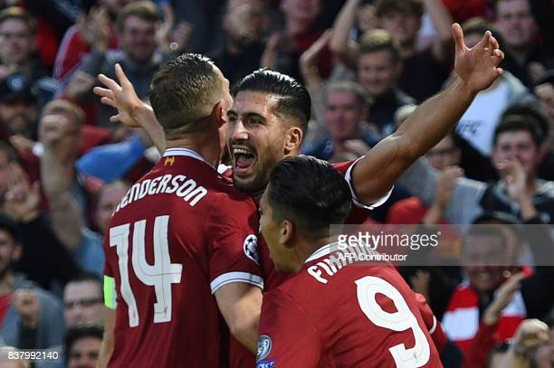 Liverpool's German midfielder Emre Can celebrates with teammates scoring the team's first goal during the Champions League qualifier second leg match...