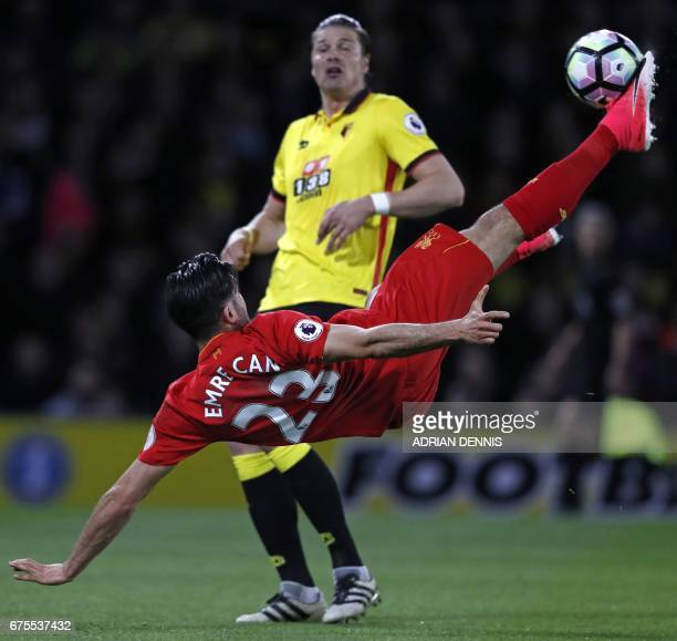 Liverpool's German midfielder Emre Can connects with this overhead kick to open the scoring in the English Premier League football match between...