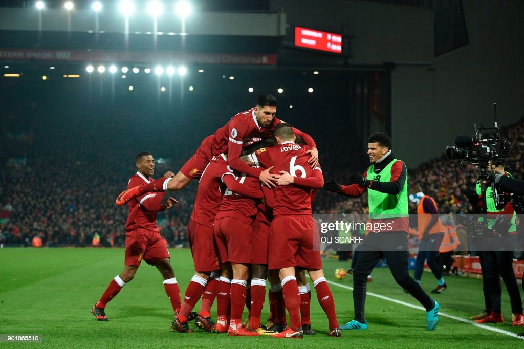 Liverpool's German midfielder Emre Can (L) jumps into the celebration for the third Liverpool goal scored by Liverpool's Senegalese midfielder Sadio Mane during the English Premier League football match between Liverpool and Manchester City at Anfield in Liverpool, north west England on January 14, 2018. / AFP PHOTO / Oli SCARFF / RESTRICTED TO EDITORIAL USE. No use with unauthorized audio, video, data, fixture lists, club/league logos or 'live' services. Online in-match use limited to 75 images, no video emulation. No use in betting, games or single club/league/player publications. /
