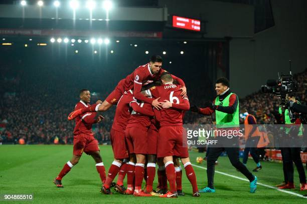 Liverpool's German midfielder Emre Can jumps into the celebration for the third Liverpool goal scored by Liverpool's Senegalese midfielder Sadio Mane...