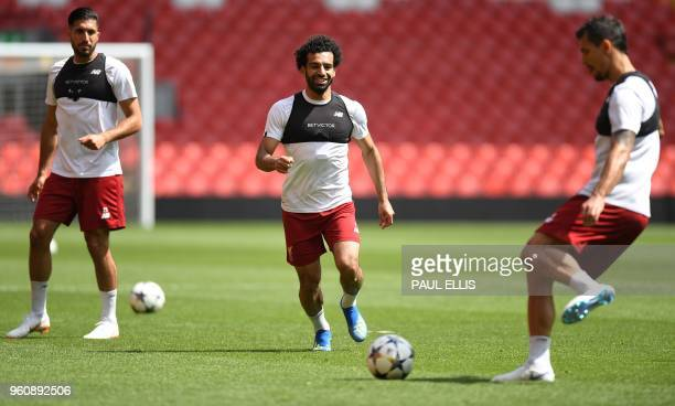 Liverpool's German midfielder Emre Can Liverpool's Egyptian midfielder Mohamed Salah and Liverpool's Croatian defender Dejan Lovren attends a...