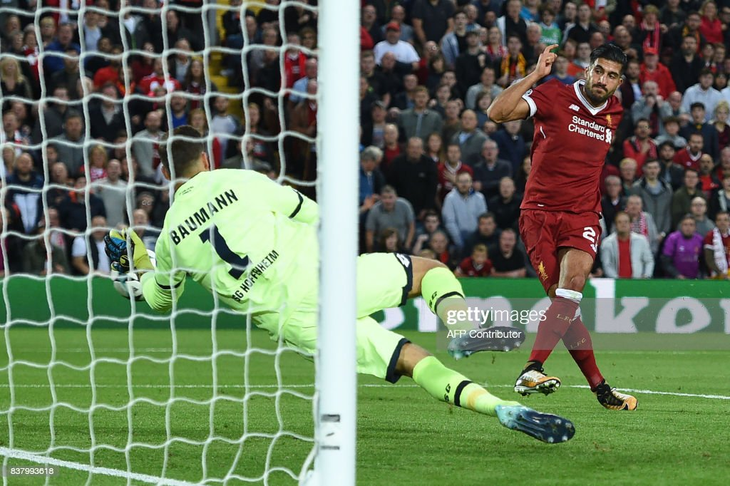 TOPSHOT - Liverpool's German midfielder Emre Can scores Liverpool's third goal during the Champions League qualifier, second leg match between Liverpool and Hoffenheim at Anfield stadium in Liverpool on August 23, 2017. / AFP PHOTO / Oli SCARFF