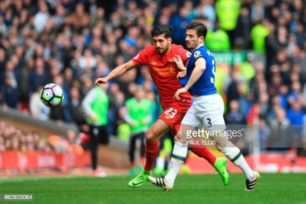 Liverpool's German midfielder Emre Can vies with Everton's English defender Leighton Baines during the English Premier League football match between...
