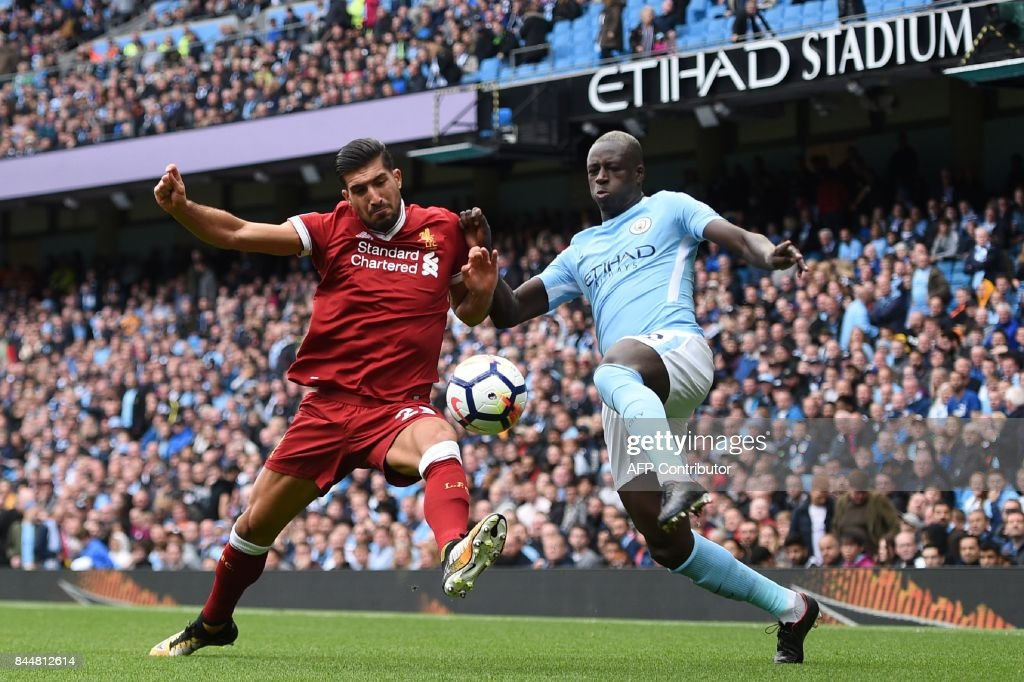 Liverpool's German midfielder Emre Can (L) vies with Manchester City's French defender Benjamin Mendy during the English Premier League football match between Manchester City and Liverpool at the Etihad Stadium in Manchester, north west England, on September 9, 2017. / AFP PHOTO / Oli SCARFF / RESTRICTED TO EDITORIAL USE. No use with unauthorized audio, video, data, fixture lists, club/league logos or 'live' services. Online in-match use limited to 75 images, no video emulation. No use in betting, games or single club/league/player publications. /