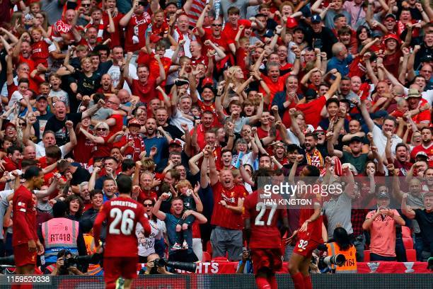 Liverpool's German-born Cameroonian defender Joel Matip celebrates in front of the Liverpool fans after scoring their first goal in the English FA...