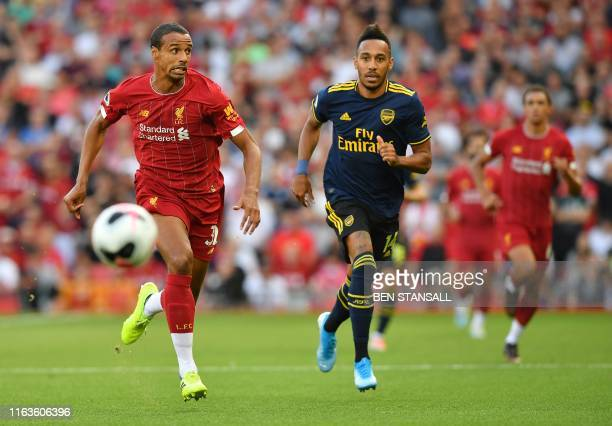 Liverpool's Germanborn Cameroonian defender Joel Matip chases after the ball alongside Arsenal's Gabonese striker PierreEmerick Aubameyang during the...