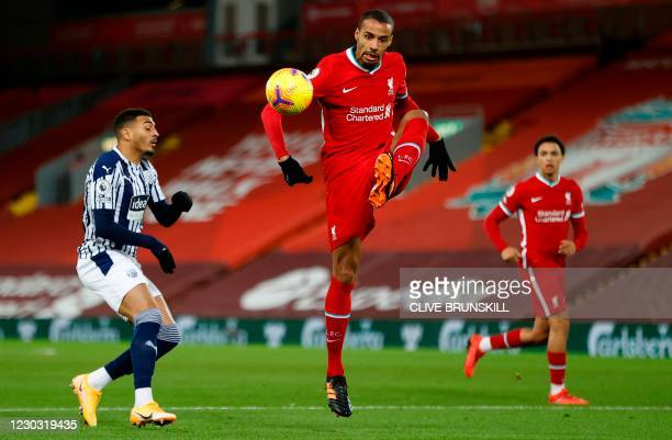 Liverpool's German-born Cameroonian defender Joel Matip controls the ball during the English Premier League football match between Liverpool and West...