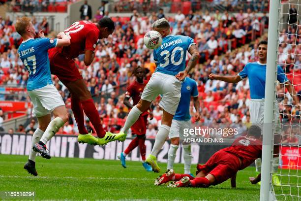 TOPSHOT Liverpool's Germanborn Cameroonian defender Joel Matip heads home from close range to make the score 11 in the English FA Community Shield...