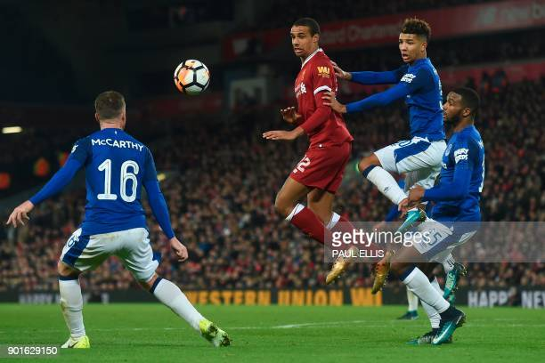 Liverpool's Germanborn Cameroonian defender Joel Matip heads the ball in front of Everton's English defender Mason Holgate during the English FA Cup...