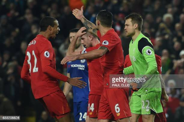 Liverpool's Germanborn Cameroonian defender Joel Matip reacts after Liverpool's Belgian goalkeeper Simon Mignolet saved a penalty by Chelsea's...