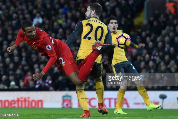 TOPSHOT Liverpool's Germanborn Cameroonian defender Joel Matip tries to reach the ball during the English Premier League football match between...