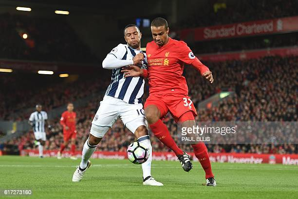 Liverpool's Germanborn Cameroonian defender Joel Matip vies with West Bromwich Albion's Englishborn Scottish midfielder Matt Phillips during the...