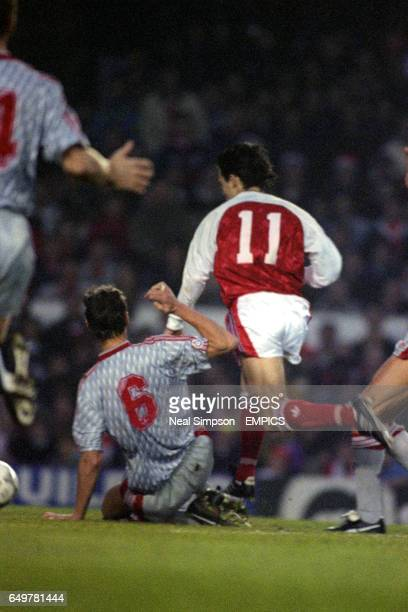 Liverpool's Glenn Hysen brings down Arsenal's Anders Limpar for a penalty