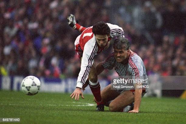 Liverpool's Glenn Hysen tackles Arsenal's Anders Limpar