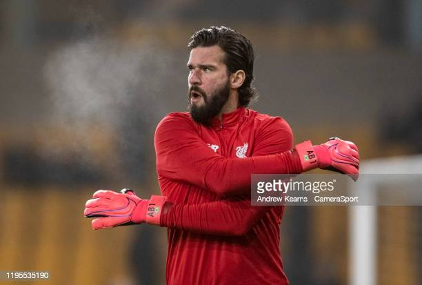 Liverpool's goalkeeper Alisson Becker warming up before the match during the Premier League match between Wolverhampton Wanderers and Liverpool FC at...