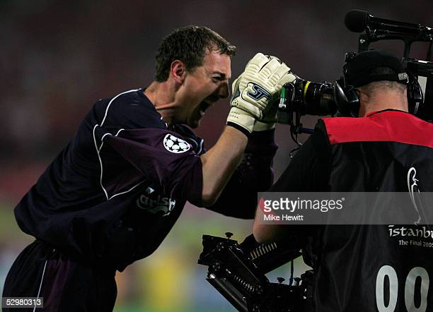 Liverpool's goalkeeper Jerzy Dudek celebrates with a TV camera after winning the European Champions League final on penalties against AC Milan on May...
