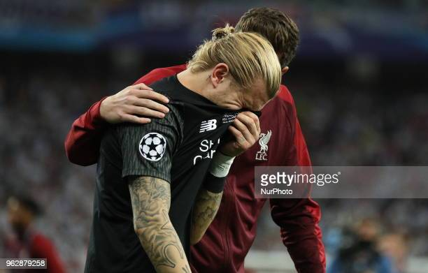 Liverpool's goalkeeper Loris Karius reacts after the final match of the Champions League between Real Madrid and Liverpool at the Olympic Stadium in...