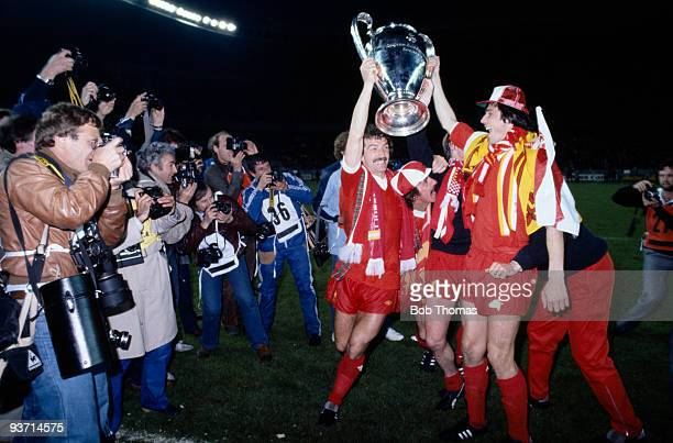 Liverpool's Graeme Souness and Alan Hansen pose with the trophy after their match with Real Madrid in the European Cup Final held at the Parc des...