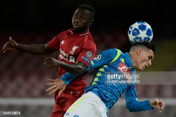 Liverpool's Guinean midfielder Naby Keita and Napoli's Spanish forward Jose Callejon go for a header during the UEFA Champions League group C...