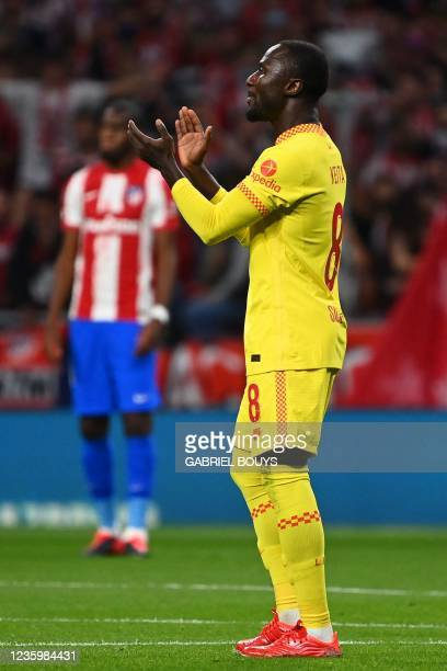 Liverpool's Guinean midfielder Naby Keita celebrates after scoring his team's second goal during the UEFA Champions League Group B football match...