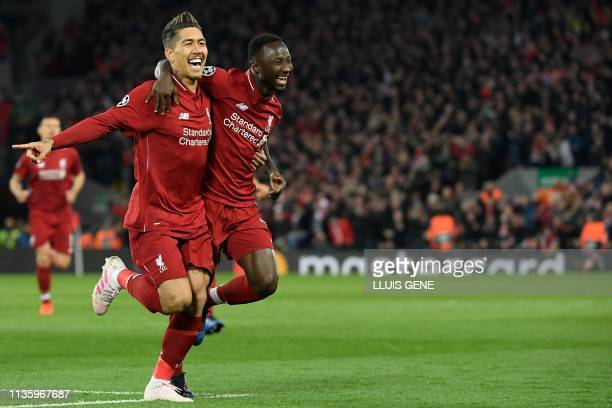 Liverpool's Guinean midfielder Naby Keita celebrates with Liverpool's Brazilian midfielder Roberto Firmino after scoring a goal during the UEFA...
