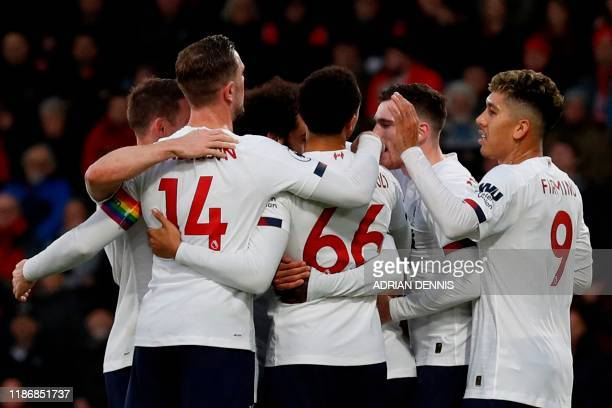 Liverpool's Guinean midfielder Naby Keita celebrates with teammates after scoring their second goal as Bournemouth's Welsh defender Chris Mepham...
