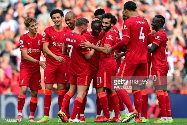 Liverpool's Guinean midfielder Naby Keita celebrates with teammates after scoring their third goal during the English Premier League football match...