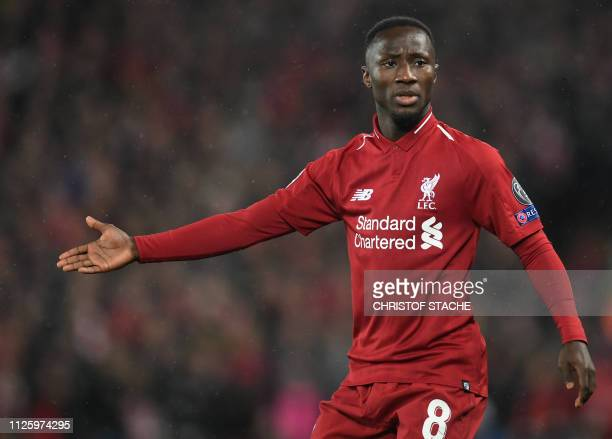 Liverpool's Guinean midfielder Naby Keita gestures during the UEFA Champions League round of 16 first leg football match between Liverpool and Bayern...