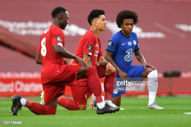 Liverpool's Guinean midfielder Naby Keita Liverpool's Brazilian midfielder Roberto Firmino and Chelsea's Brazilian midfielder Willian 'take a knee'...