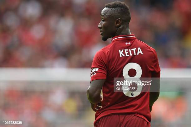 Liverpool's Guinean midfielder Naby Keita makes his Premier League debut during the English Premier League football match between Liverpool and West...