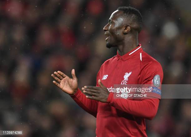 Liverpool's Guinean midfielder Naby Keita reacts during the UEFA Champions League round of 16 first leg football match between Liverpool and Bayern...