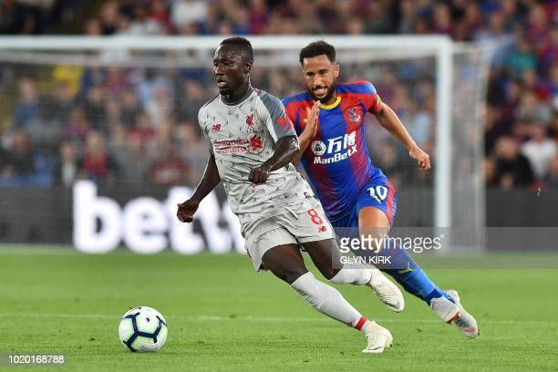 Liverpool's Guinean midfielder Naby Keita runs away from Crystal Palace's English midfielder Andros Townsend during the English Premier League...