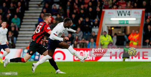 Liverpool's Guinean midfielder Naby Keita scores their second goal during the English Premier League football match between Bournemouth and Liverpool...