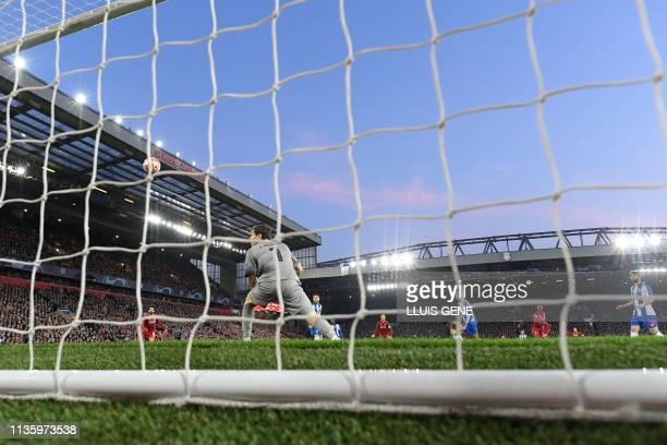 Liverpool's Guinean midfielder Naby Keita shoots and scores a goal during the UEFA Champions League quarterfinal first leg football match between...