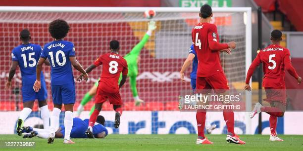 Liverpool's Guinean midfielder Naby Keita watches his shot score the opening goal during the English Premier League football match between Liverpool...