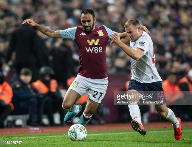 Liverpool's Herbie Kane competing with Aston Villa's Ahmed Elmohamady during the Carabao Cup Quarter Final match between Aston Villa and Liverpool FC...