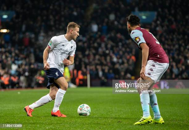 Liverpool's Herbie Kane competing with Aston Villa's Neil Taylor during the Carabao Cup Quarter Final match between Aston Villa and Liverpool FC at...