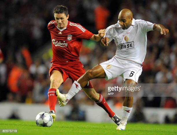 Liverpool's Irish forward Robbie Keane vies with Standard Liege French midfielder Wilfried Dalmat during their UEFA Champions League Third qualifying...